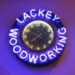 Lackey Woodworking neon clock with bullet holes and rust .